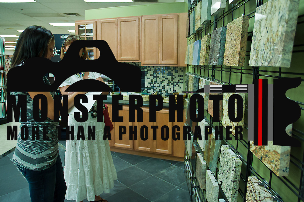 07/29/11 Wilmington DE: Design Consultant Lindsay Conley (Left) assist costumer Karen Kossek (Right) with the sale of granite counter top tiles Friday July 29, 2011, at the Tile Market of Delaware in Wilmington Delaware...Special to The News Journal/SAQUAN STIMPSON
