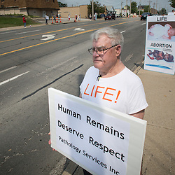 Lisa Johnston | lisajohnston@archstl.org  | Twitter: @aeternusphoto  Jerry Jacobsmeyer and Rudy Mendez stood with Defenders of the Unborn at a protest in front of Pathology Services Inc. on Brentwood Blvd.  The company is employed by Planned Parenthood of St. Louis to examine the babies who have been aborted.  About three dozen protesters stood along the busy corridor in St. Louis in 95 degree heat wanting to know what happens to the baby remains after they are examined inside the building.