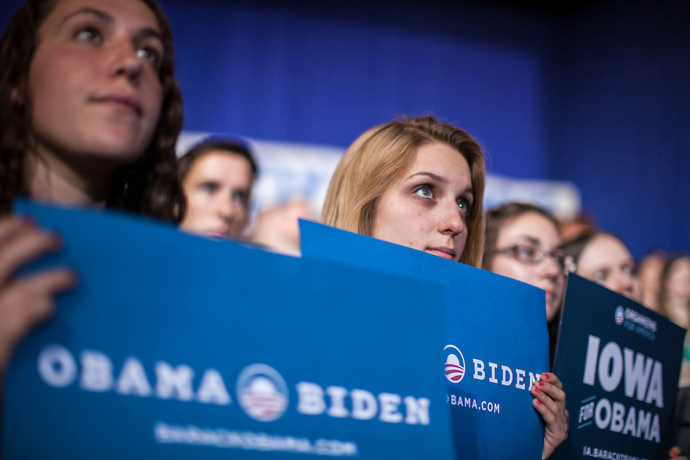 Audience members listen as Vice President Joe Biden speaks at a rally at Grinnell College during a two-day campaign swing through Iowa on Tuesday, September 18, 2012 in Grinnell, IA.