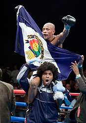Valdemir Pereira celebrates his win over Phafrakorb Rakkietgym for the IBF Featherweight title fight at the Foxwoods Hotel and Casino.  Pereira captured the vacant title with a unanimous decision win