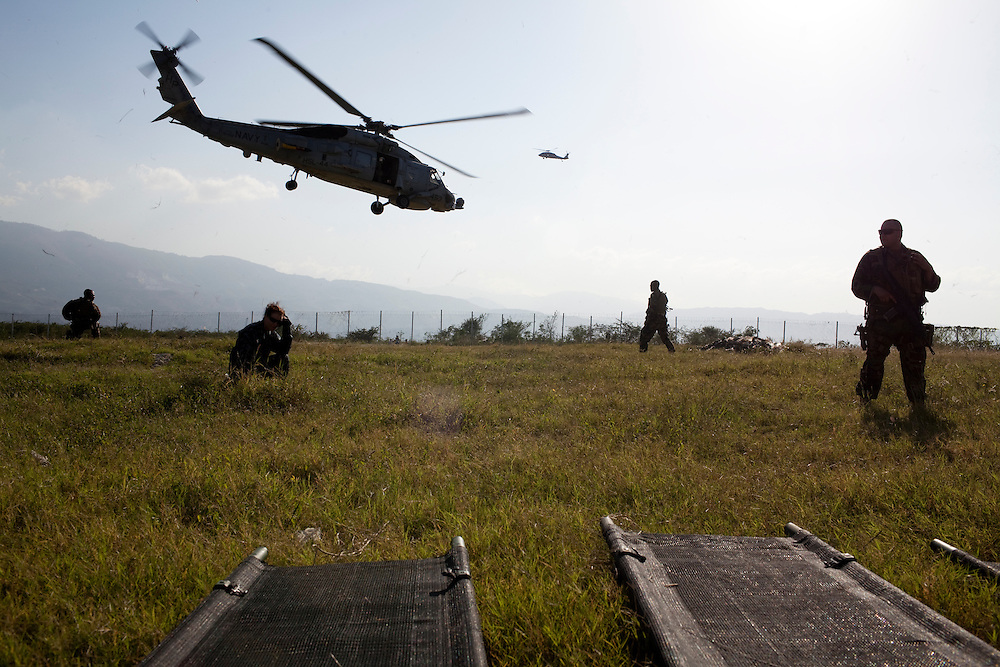 An MH-60S helicopter takes off to transport victims of the recent earthquake to the USNS Comfort, a naval hospital ship, in Port-au-Prince, Haiti.
