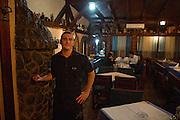 Waiter (name TK) at Savski Express restaurant.<br /> <br /> Savamala neighborhood of Belgrade, Serbia.