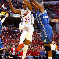 INDIANAPOLIS, IN - OCTOBER 21: Tamika Catchings #24 of the Indiana Fever shoots against Taj McWilliams-Franklin #8 of the Minnesota Lynx during Game Four of the 2012 WNBA Finals on October 21, 2012 at Bankers Life Fieldhouse in Indianapolis, Indiana. NOTE TO USER: User expressly acknowledges and agrees that, by downloading and or using this Photograph, user is consenting to the terms and conditions of the Getty Images License Agreement. (Photo by Michael Hickey/Getty Images) *** Local Caption *** Tamika Catchings; Taj McWilliams-Franklin