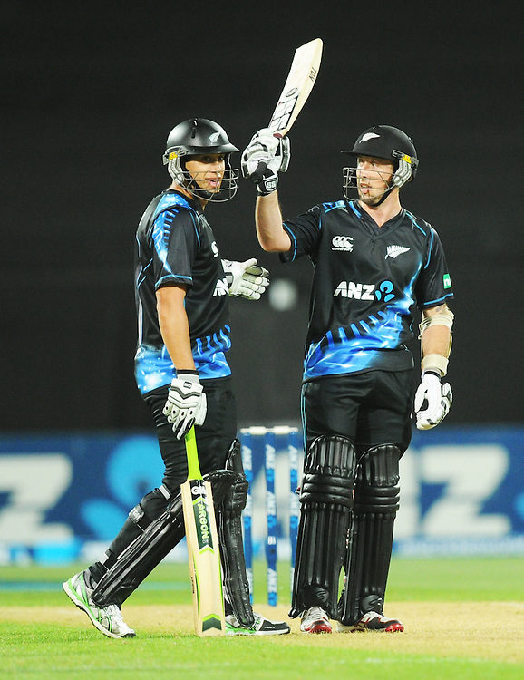 New Zealand's Luke Ronchi, right, celebrates his 50 with Ross Taylor against West Indies in the second T20 International cricket match, Westpac Stadium, Wellington, New Zealand, Wednesday, January 15, 2014. Credit:SNPA / Ross Setford