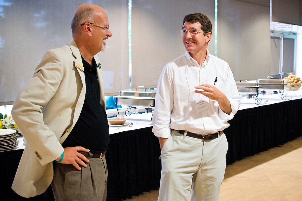 (photo by Matt Roth).Friday, July 20, 2012..Dr. Roger Casey, president of McDaniel College talks with parent Timothy Blair, from Birmingham, AL during the President's Banquet at McDaniel College's Parent Preview Friday, July 20, 2012.