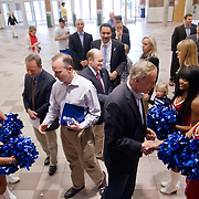 Delaware Gov. Jack Markell, from left, and Sen. Tom Carper, D-Del greet Sixers dance team members as they enter the Philadelphia 76ers press event Saturday. April 27, 2013,  at The Bob Carpenter Center in Newark, Del..Also pictured is Philadelphia 76ers managing owner Josh Harris , from left, Sen. Chris Coons, D-Del and NBA Development League president Dan Reed (Back)...(AP Photo/Saquan Stimpson)