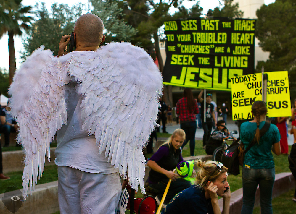 A Trump supporter dressed as an angel stands with other attendees on campus at the MSNBC stage to get their voices heard outside during the final 2016 Presidential Debate at UNLV on Wednesday, Oct. 19, 2016.