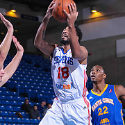 Delaware 87ers Guard DJ Seeley (18) drives towards the basket as Santa Cruz Warriors Guard Aaron Craft (14) defends in the first half of a NBA D-league regular season basketball game between the Delaware 87ers and the Santa Cruz Warriors (Golden State Warriors) Tuesday, Jan. 13, 2015 at The Bob Carpenter Sports Convocation Center in Newark, DEL