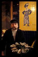 Oysterman in a Paris seafood restaurant - Photograph by Owen Franken