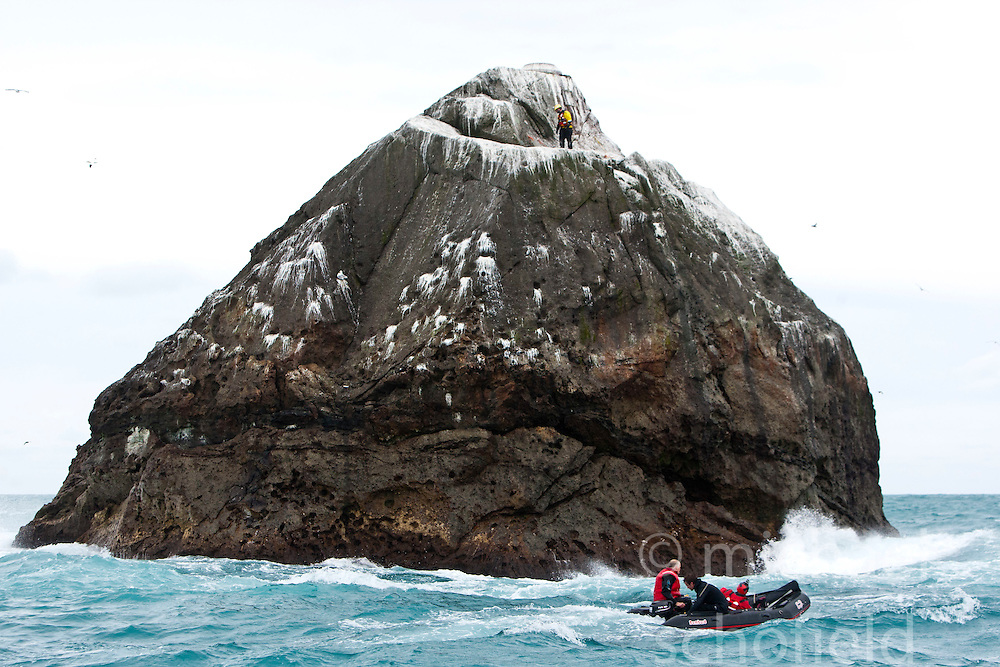 Nick Hancock (yellow dry suit), scrambles up the face of Rockall, on his reconnaissance mission for a future 60 day occupation of Rockall, an extremely small, uninhabited, remote rocky islet in the North Atlantic Ocean. .The Rockall Jubilee Expedition, a unique endurance expedition to be undertaken by Nick, in order to raise funds for Help for Heroes.