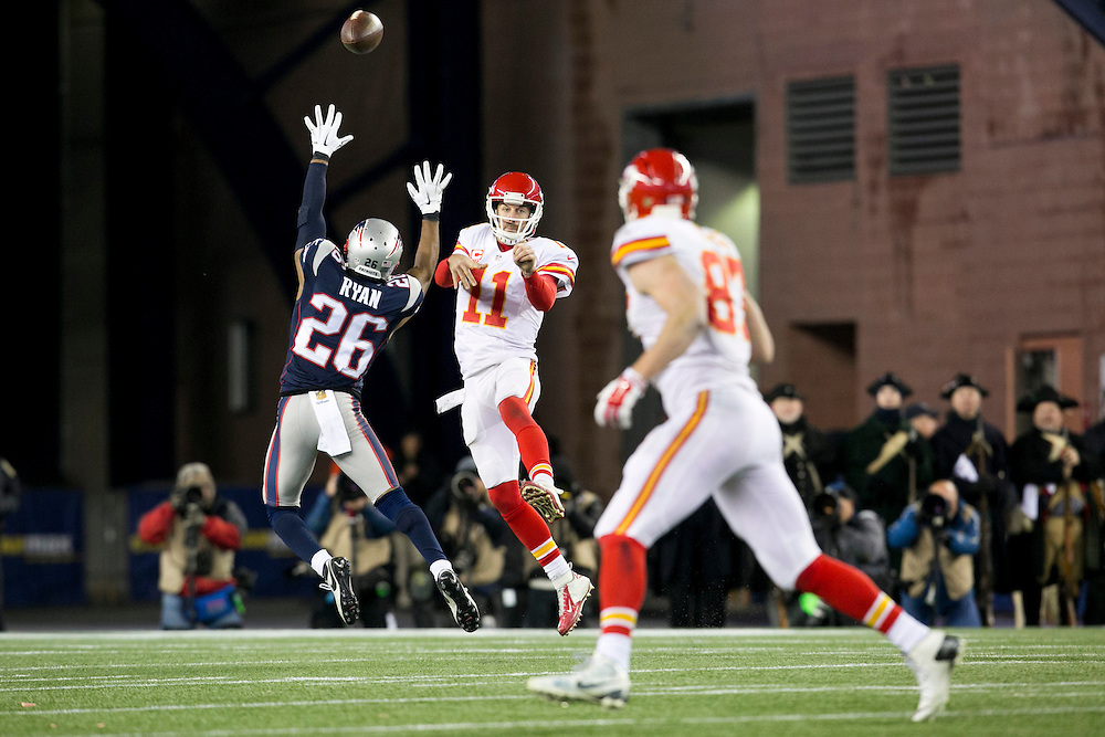 Kansas City Chiefs quarterback Alex Smith (11) gets pressured by New England Patriots cornerback Logan Ryan (26) as he passes to Chiefs tight end Travis Kelce (87) in the fourth quarter of the AFC Divisional Playoff game at Gillette Stadium in Foxborough, Massachusetts on January 16, 2016. The Patriots defeated the Chiefs, 27-20.    Photo by Kelvin Ma/ UPI