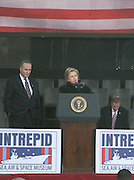 l to r: U.S. Senator Charles Schumer and U.S. Hillary Clinton at The 2008 Veterans Day  Ceremonies at the Intrepid Sea, Air, & Space Musem on November 11, 2008 in NYC