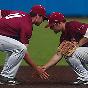Saint Joseph's Infielder Matt Maul (11) and Saint Joseph's Infielder Taylor Boyd (2) performs a pre-inning ritual during a regular season baseball game between Delaware and Saint Joseph's at Bob Hannah Stadium Tuesday April 19, 2016, in Newark.