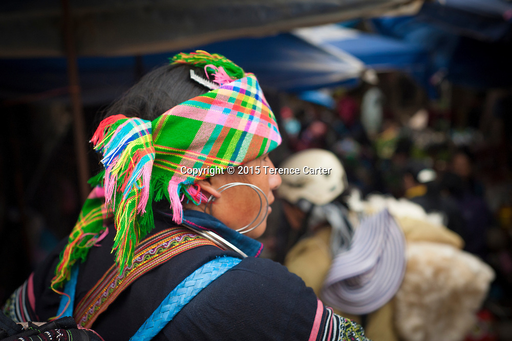 A hilltribe woman wears a distictive scarf in the markets in Sapa, Vietnam.