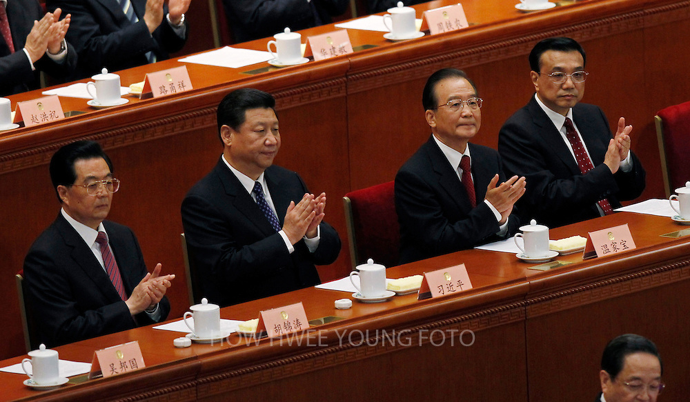 epa03607755 (L-R) Chinese outgoing President Hu Jintao, his successor and Communist Party Chief Xi Jinping, outgoing Premier Wen Jiabao and Vice-Premier Li Keqiang clap during the opening of the first session of the 12th National Committee of the Chinese People's Political Consultative Conference (CPPCC) at the Great Hall of the People, in Beijing, China, 03 March 2013. The CPPCC is the top advisory body of the Chinese political system and the session precedes the annual plenary meetings of the 12th National People's Congress (NPC) which is due to commence 05 March.  EPA/HOW HWEE YOUNG