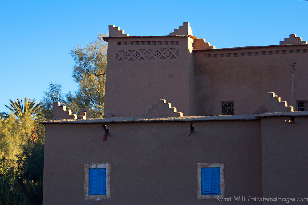 Africa, Morocco, Skoura. Kasbah with blue window shutters.