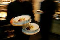Waiters leaving the kitchen of Restaurant Daniel, of Chef Daniel Boulud, New York City - Photograph by Owen Franken