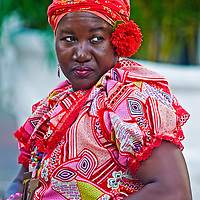 CARTAGENA , COLOMBIA - DEC 24 : Palenquera woman sell fruts in Cartagena ,Colombia on December 24 2010 , Palenqueras are  a unique African descendat ethnic group found in the north region of South America