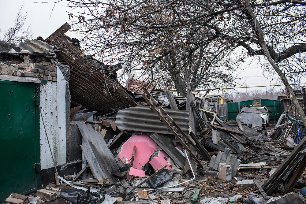 PIKSY, UKRAINE - NOVEMBER 19, 2014: The destroyed house of Yuri Siderov and his wife Lyubov in Pisky, Ukraine. The village of Pisky is the scene of much of the front-line fighting over the Donetsk airport, but Siderov and his wife have stayed to care for their two cows. CREDIT: Brendan Hoffman for The New York Times