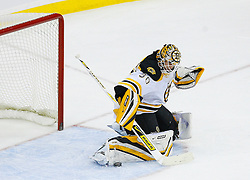 Dec 23, 2008; Newark, NJ, USA; Boston Bruins goalie Tim Thomas (30) makes a pad save during the third period  of their game against the New Jersey Devils at the Prudential Center. The Bruins defeated the Devils 2-0.