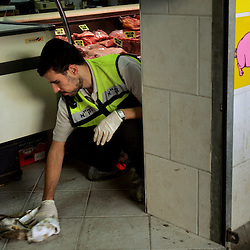 An Israeli rescue worker is seen clearing the scene of a suicide bomb attack in Tel Aviv, Israel, Nov. 1, 2004. Three people were killed and dozens were wounded when Palestinian Aamer Alfar, 16, blew himself up in a crowded open-air food market in the heart of Israel's commercial capital. He was from the Askar refugee camp near the northern West Bank city of Nablus.
