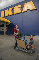"""""""I would like to open an environmentally friendly kid's boutique.""""   -Cassandra Frantz with her daughters, Vaughn and Noemi,  outside the IKEA in Emeryville, CA"""