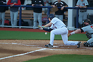 Ole Miss' Auston Bousfield (9) attempts a bunt vs. Arkansas State in baseball action at Oxford-University Stadium in Oxford, Miss. on Tuesday, February 21, 2012. Ole Miss won the home opener 8-1 to improve to 2-1 on the season. Arkansas State dropped to 0-3.