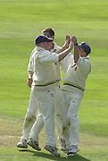 Photo Peter Spurrier.01/09/2002.Village Cricket Final - Lords.Elvaston C.C. vs Shipton-Under-Wychwood C.C..Elvaston's  James bodill (left) is congratulated by team mates after running out Shipton's Phil Garner.