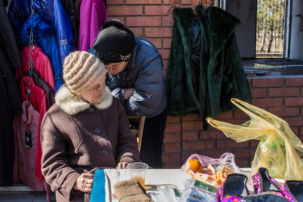 Vendors at the Kievsky Market, which on January 24 suffered a direct hit by a number of Grad rockets, on Sunday, March 8, 2015 in Mariupol, Ukraine. Photo by Brendan Hoffman, Freelance