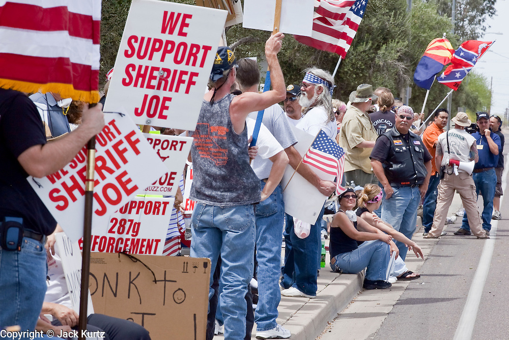 02 MAY 2009 -- PHOENIX, AZ: People in support of Sheriff Joe Arpaio stand on Durango in front of the jail Saturday. About 1,500 people opposed to Sheriff Joe Arpaio's treatment of prisoners and his high profile crime suppression anti-undocumented raids, marched from his office to downtown Phoenix to the jail complexes on Durango in south Phoenix Saturday. There were about 50 pro-Arpaio counter demonstrators in front of the jail. Photo by Jack Kurtz