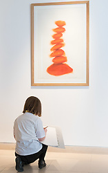 Christies, St James, London, March 4th 2016. Nine year-old Ashley Hubbard from Charlton Manor Primary School does a drawing on David Nash's &quot;Column&quot;, created especially for the auction at the preview for the It&rsquo;s Our World charity auction at Christie's. Over 40 leading artists including David Hockney, Sir Antony Gormley, David Nash, Sir Peter Blake, Yinka Shonibare, Sir Quentin Blake, Emily Young and Maggi Hambling have committed artworks to the It&rsquo;s Our World Auction in support of The Big Draw and Jupiter Artland Foundation, to be sold at Christie&rsquo;s London on 10 March 2016.<br />  ///FOR LICENCING CONTACT: paul@pauldaveycreative.co.uk TEL:+44 (0) 7966 016 296 or +44 (0) 20 8969 6875. &copy;2015 Paul R Davey. All rights reserved.