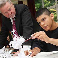 Rod Aldridge visits Falmer High School.This picture: Olsen Bodden 15 with his paper sculpture.Pics: Jonathan Goldberg.