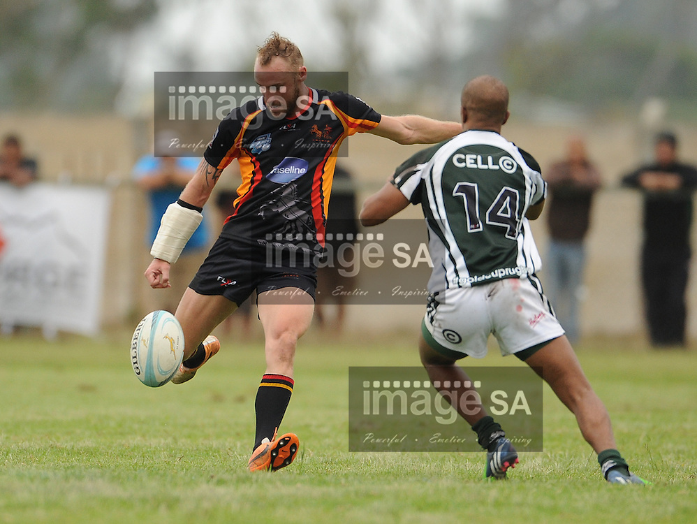 GEORGE, SOUTH AFRICA - Saturday 7 March 2015, Craig Kolarik of Vaseline Wandeers kicks the ball over the head of Joseph Fortuin of Pacaltsdorp Evergreens during the third round match of the Cell C Community Cup between Pacaltsdorp Evergreens and Vaseline Wanderers at Pacaltsdorp Sports Grounds, George<br /> Photo by Roger Sedres/ImageSA/ SARU
