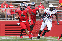 Sept 8, 2012; Piscataway, NJ, USA; Rutgers Scarlet Knights quarterback Gary Nova (15) runs with the ball while being chased by Howard Bison defensive end Toavon Sheats (90) during the first half at High Point Solutions Stadium.