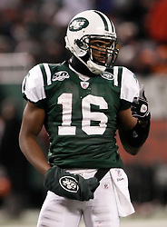 Jan 3, 2010; East Rutherford, NJ, USA; New York Jets wide receiver Brad Smith (16) gives the thumbs up to the sidelines during the first half at Giants Stadium.