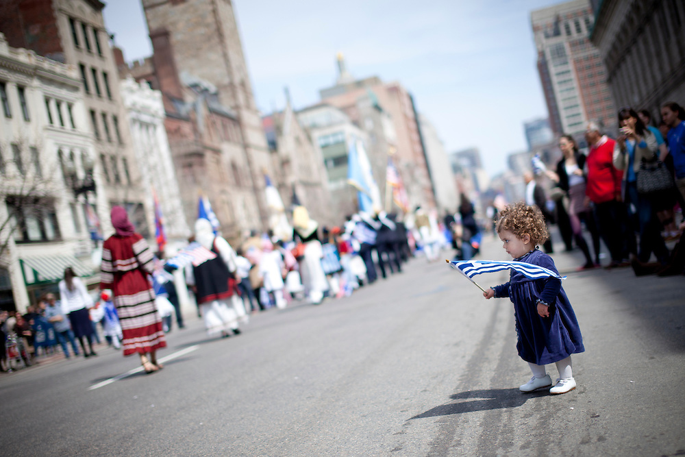 A girl waves a Greek flag during the 17th Greek Independence Day parade in Boston April 7th, 2011.