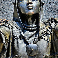 Saura Indian Woman at Museum of History in Raleigh, North Carolina<br /> This bronze statue on the steps of the North Carolina Museum of History in Raleigh is called Sauratown Woman. The likeness was recreated from the archeological remains of an 18 to 21 year old Native American buried in the village of Upper Sauratown. The plague explains she is a Saura Indian who lived along the Dan River in the late 1600s. &ldquo;The deerskin dress and hood suggests a high status in the tribe.&rdquo; The sculpture is the work of Virginia artist Alvaro Coronado.