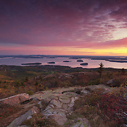 For much of the year, Cadillac Mountain in Acadia Natonal Park, Maine is the first to receive the rays of the morning sun. No visit to the park, when the road is passable, is complete without watching the sunrise on the summit. Here, you can see the town of Bar Harbor and the islands of Frenchman's Bay.