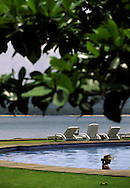 Woman on the pool of Pestana Resort. This hotel is located in Ilheu das Rolas (Pidgeon island) on the southern tip of Sao Tome island.