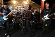 Ireland. Dublin. U2 rehearsing in their studios in Dublin. Left to right: The Edge, Larry Mullen, Bono and Adam Clayton..