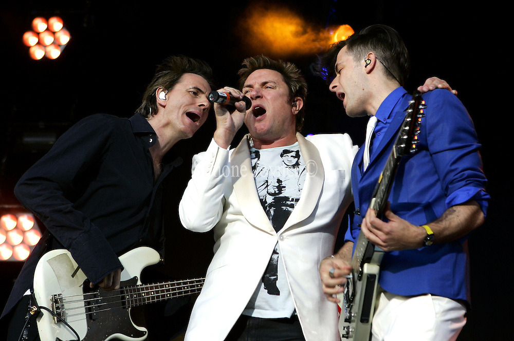 John Taylor (L) and Simon LeBon (C) of Duran Duran join Mark Ronson as he performs live on the main stage during day two of the Love Box Weekender 2010 at Victoria Park on July 17, 2010 in London, England.  (Photo by Simone Joyner)