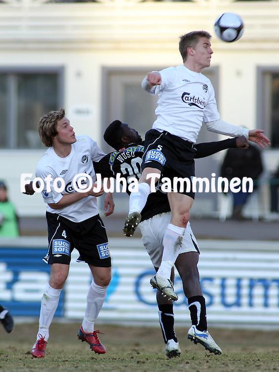 19.04.2010, Tehtaankentt?, Valkeakoski..Veikkausliiga 2010, FC Haka - FC TPS Turku..Markus Joenm?ki & Kalle Parviainen (Haka) v Babatunde Wusu (TPS).©Juha Tamminen.