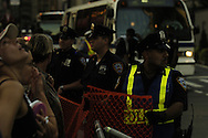 New York City police use mesh netting to control pedestrian crowds near the site of the Republican National Convention during the President's party nomination September 2, 2004 in New York City.