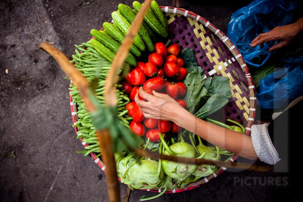 Bird's eye view of a street vendor's basket filled with veggies, Hanoi, Vietnam, Southeast Asia