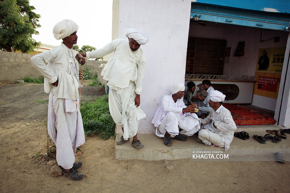 Gujarati men spending a nice evening time together in a village shop near Bhuj, Gujarat