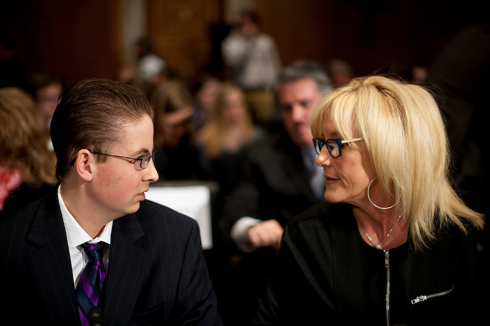 "Trevor Schaefer, youth ambassador and founder of Trevor's Trek Foundation, Erin Brockovich, president of Brockovich Research & Consulting testify before an Environment and Public Works Committee during a hearing on ""Oversight Hearing on Disease Clusters and Environmental Health."""