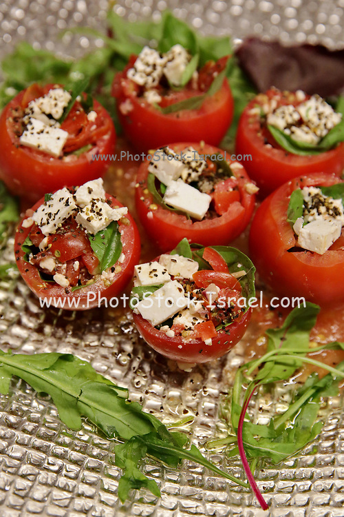 Stuffed tomatoes - tomatoes filled with cheese and basil