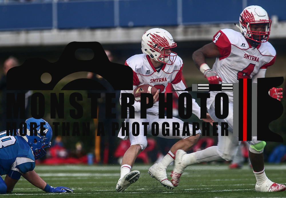 Smyrna quarterback Nolan Henderson (2) scrambles out of the pocket during the DIAA division one Football Championship game between Top-seeded Middletown (11-0) and second-seeded Smyrna (11-0) Saturday, Dec. 03, 2016 at Delaware Stadium in Newark.