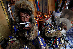 Exhausted, Mongolian Shaman Gankhuyag Batmunkh (L) drinks a bowl of milk after coming out of his trance while his brother Batgerel (R), still possessed by the spirit sits beside him in their ger on the outskirts of Ulan Bator, Mongolia, 04 July 2012. Mongolian brothers Gankhuyag and Batgerel Batmunkh share a similar fate. Both were construction workers before fate calls on them to take on their Shamanic roles to serve the spirits. Shamanism comes from the term 'shamans' that refers to priests or mediums that acts as vessels for spirits, gods and demons to communicate with the human world. In Mongolia, they adhere to the ancient beliefs of Tengrism, where spirits live in all of nature, in the sun, moon, lakes, rivers, mountains, and trees.