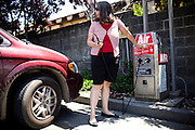 Sharon Ferrell airs up her leaky car tire periodically, since she can't afford to repair it in Lincoln, CA  May 13, 2009.